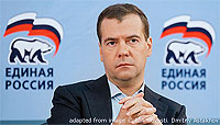 File Photo of Dmitry Medvedev with United Russia Logos Behind Him