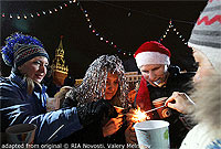 File Photo of New Year's Eve Revelers With Sparkler Near Kremlin