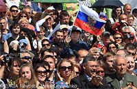 File Photo of Crowd of Russians with One Waving Russian Flag