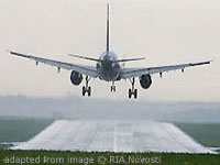 File Photo of Airplane Approaching Runway About to Land