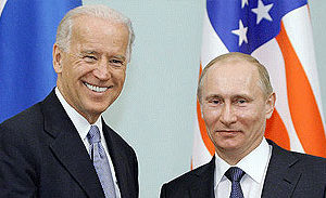 File Photo of Joe Biden and Vladimir Putin in front of U.S. Flag and Russian Flag, adapted from image from RIA Novosti