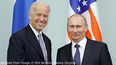 File Photo of Joe Biden and Vladimir Putin in front of U.S. Flag and Russian Flag