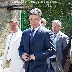 Petro Poroshenko file photo, with additional men in background, adapted from image at state.gov