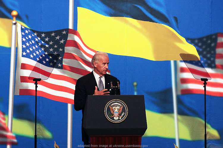 File Photo of Joe Biden at Podium with U.S. Seal, With Ukrainian and U.S. Flags in Background
