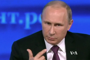 Vladimir Putin file photo with VOA logo; screen shot from video still