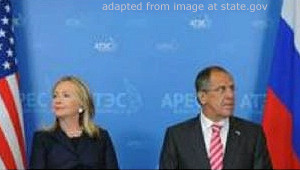 Hillary Rodham Clinton and Sergei Lavrov, Seated With Flags