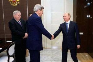 File Photo of John Kerry Shaking Hands with Vladimir Putin as Ambassador Looks On