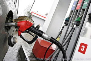 Gas Pump File Photo with Nozzle in Car