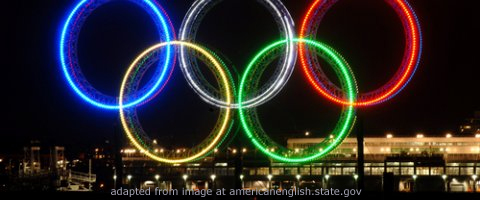 Olympic Rings Lit at Night, adapted from image at state.gov
