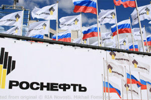File Photo of Rosneft and Russian Flags Next to Rosneft Banner