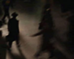 Stylized Artist's Depiction of Shadowy Figures in Dark Coats and Dark Hats, One Carrying a Briefcase