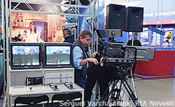 Adapted File Photo of TV Set in Russia with Camera, Camerman, Woman on Set in Background