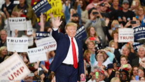 File Photo of Donald Trump Waving Before Large Crowd with Trump Signs, adapted from image at whitehouse.gov