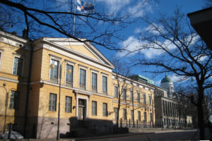 "File Photo of the Aleksanteri Institute, University of Helsinki, adapted from an image at the Wikimedia Creative Commons, attributed to John Welsh/Welshentag, with conditions on reuse, declaring ""This file is licensed under the Creative Commons Attribution-Share Alike 2.0 Generic license. You are free: to share – to copy, distribute and transmit the work to remix – to adapt the work Under the following conditions: attribution – You must attribute the work in the manner specified by the author or licensor (but not in any way that suggests that they endorse you or your use of the work). share alike – If you alter, transform, or build upon this work, you may distribute the resulting work only under the same or similar license to this one."""