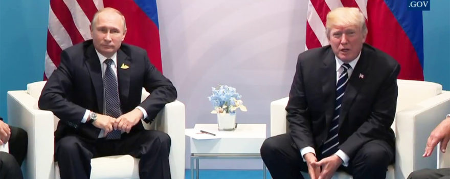 Vladirmir Putin and Donald Trump Sitting in Chairs with Flags Behind, adapted from image at whitehouse.gov
