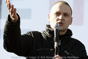 File Photo of Sergei Udaltsov Speaking Outdoors, Holding Microphone and Gesturing