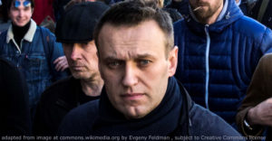 File Photo of Alexei Navalny Marching on Street with Others in Background; adapted from image at commons.wikimedia.org with credit to Evgeny Feldman, subject to Creative Commons license; original image at commons.wikimedia.org/wiki/File:FEV_1795_(cropped1).jpg, with license information at creativecommons.org/licenses/by-sa/4.0/deed.en and creativecommons.org/licenses/by-sa/4.0/legalcode
