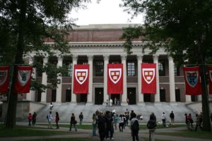 File Photo of Library at Harvard University with Banners and Persons Walking on Quad, from image at state.gov