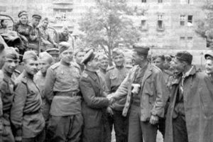 American Solider Meets Russian Soliders in Berlin in 1945, adapted from image at army.mil