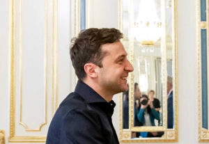 File Photo of Zelenskiy Extending Handshake, adapted from image at a subdomain of senate.gov