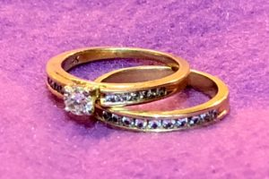 File Photo of Wedding Ring and Engagement Ring, adapted from image at fnal-gov
