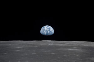 File Photo of Surface of Moon with Earth in Distance, adapted from NASA image