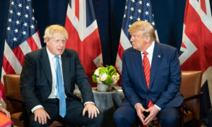 File Photo of Boris Johnson and Donald Trump, Sitting Before U.S. and British Flags, adapted from image at usembassy.gov with photo credit as official White House photo by Shealah Craiughead