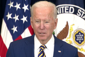 File Photo of Joe Biden at Podium in Front of U.S. and State Department Flags, adapted from image at usembassy.gov