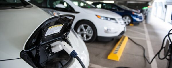 File Photo of Electric Cars being charged, adapted from image at doe.gov
