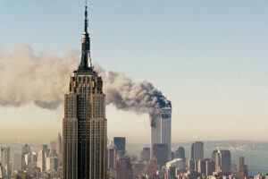 File Photo of Empire State Building and World Trade Center Burning in Background on 9/11, adapted from image at defense.gov